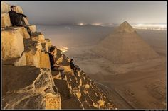Russian hikers climb the Pyramids of Giza.