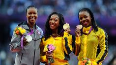 Women's 100m medallists pose during Victory Ceremony -  (L-R) Silver medalist Carmelita Jeter of the United States, gold medalist Shelly-Ann Fraser-Pryce of Jamaica and bronze medalist Veronica Campbell-Brown of Jamaica pose on the podium for Women's 100m on Day 9.  http://www.london2012.com/photos/latestpictures.html#