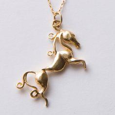 Horse Pendant, Gold Pendant, horses gold pendant, horse necklace, equestrian pendant. $90.00, via Etsy.
