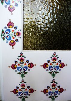Folk doors - close-up. Decoupage technique.  Pattern: Polish paper cutting (Wycinanki) folk art. Łowicz region.