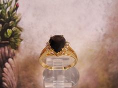 1970s Pear Shaped Brown Topaz Colored Stone with 6 Austrian Crystal Clear Round Accent Stone set in a Gold Tone Ring – Size 10 by CarolsVintageJewelry on Etsy