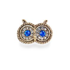 Hooting owl stretch ring with irresistible bright blue sapphire eyes surrounded by black diamond crystal stone pave accents. Stretch base allows for multiple fit. Available in one size.