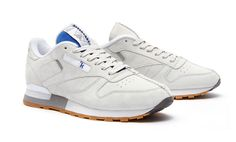 Kendrick Lamar reworks the Reebok Classic Leather with a center seam and dual blue and red accents