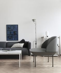 Cool bold poster in black and blue Bonjour in a white scandi living room by time of the aquarius