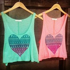 Twinning tank tops either blue or pink