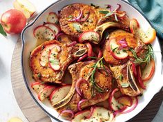 Skillet Apple Pork Chops | Just like our Skillet Apple Chicken Thighs, but with pork. This twist on an easy one-pot recipe is weeknight-fast yet fit for company and makes us simply giddy for fall. The chops will finish cooking in the apple mixture, and get ready, because your kitchen is about to smell like a crisp, Autumn breeze.