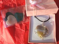 Beautiful polished stone guitar pics in colorful heart-shapes! Wire holders by artisanstudioworks.com