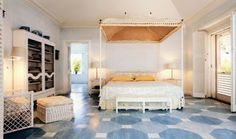 Love this from Bunny Mellon's Caribbean estate, on the market, one of 2 master bedrooms. what a cool floor, love the entire house but, unfortunately don't have a pot, a huge pot, of gold to purchase it. Pretty bed too!