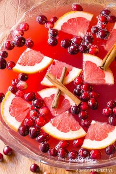 Vibrant Holiday Champagne Punch Recipe on ASpicyPerspective.com #newyearseve #christmas