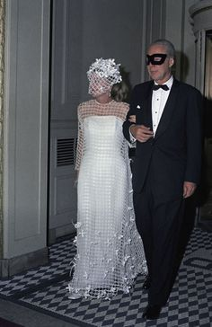 "Photo honoring Joan  Fontaine on Tributes.com. ""Actress Joan Fontaine, in white dress, is escorted by Dr. Benjamin Kean to Truman Capote's Black and White Ball at New York's Plaza Hotel on November 28, 1966. Couple at left is unidentified. Capote set the fashion tone by insisting that his female guests wear black and white. Dr. Kean, a noted parasitologist and pathologist, is world famous for his expertise on infectious diseases. """