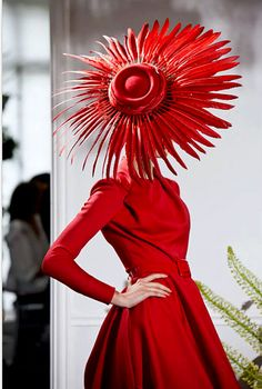 Wonderful red hat . You could make one in this shape from a baseball cap with the bill removed. I don't use feathers. Instead try foam, stiff fabric or cardboard. then spray paint.