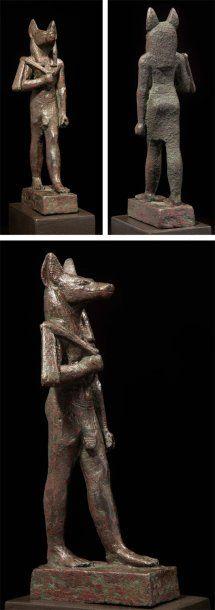 STATUE votive representing the god Anubis.Bronze. Egypt, Late Period, Dynasty XXVI-XXX.