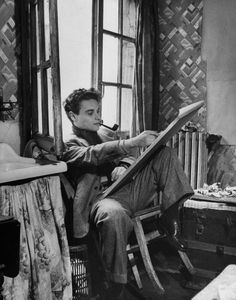 An art student painting in his attic apartment. Photograph by Nat Farbman. Paris, November 1948.