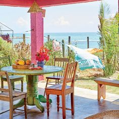 The Dining Porch - Bohemian Jamaican Beach Cottage - Coastal Living