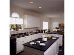 Open kitchen with large island | Plan 024D-0056 | House Plans and More