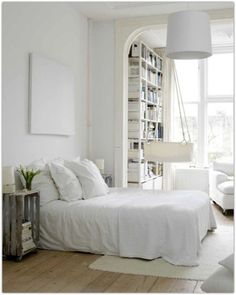 Bedroom:White Themed For Astounding Scandinavian Interior Design Bedroom With Pendant Lighting And Bookshelf Feat Lounge Chairs Plus Cream Fur Rugs And Wooden Floor Scandinavian Bedroom Design Furniture Ideas Scandinavian Interior Design Bedroom Ideas
