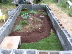 Perhaps with cinder blocks lined up so that the screen covers 1/2 the block and I can plant in the 'outside' hole. Also paint outside of block.