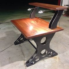 Custom ordered desk make from 3/16 inch hot rolled steel, Sapelli Wood with LED lighting and Power Strip for full on functionality. It