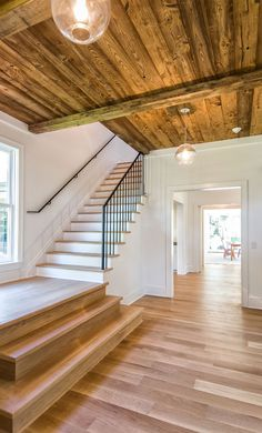 White Oak Floors, Black Iron Rails, Glass Fixtures, White walls