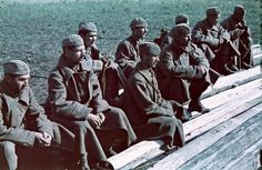 Group of captured Soviet Red Army soldiers waiting to be moved from the field to the rear.