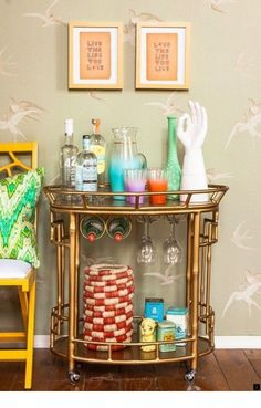 Image 7 of 18 from gallery of Cool Bar Cart Accessories: The Styling Ideas. Oval gold bamboo bar cart accessories with white hand and yellow dog statue accessories Bar Cart Styling, Bar Cart Decor, Home Modern, Contemporary Home Decor, Bar Cart Essentials, Dyi, Gold Bar Cart, Decor Scandinavian, Home Living
