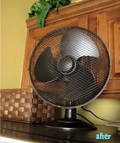 spray paint an ugly fan with oil-rubbed-bronze spray paint for a expensive pottery barn looking fan.