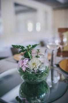 fishbowl centerpiece, photo by Rad + In Love http://ruffledblog.com/kona-kai-resort-wedding #weddingideas #centerpieces