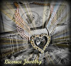 e Golden Flying Winged Crystal Heart Rhinestone Statement Necklace  by LicoriceJewelry