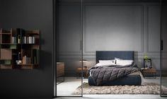 Кровать со сменной обивкой отличается высокой головной спинкой с приятным швом с шестиугольным орнаментом. Широкий выбор размеров, а также вариант с контейнером.