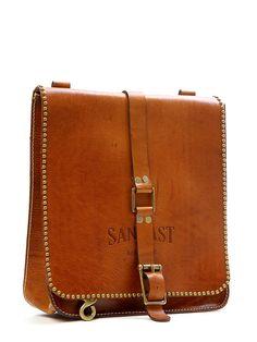 Latigo leather with brass studs around the flap
