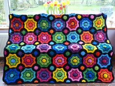Realta Afghan.... now that is one bright afghan! Pattern on Ravelry