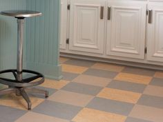 "marbled-finish Marmoleum tiles. Changing to stone would have raised the height of the floor and crept into the baseboards, and it would've cost double,"" says Sarah. Get the look: Marmoleum Click vinyl tile, from $7 per square foot, forbo-flooring.com for buying info"
