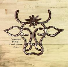 """Miss Moo"" - designed and made with steel horseshoes by Rustic Horseshoe Designs in Western Australia"