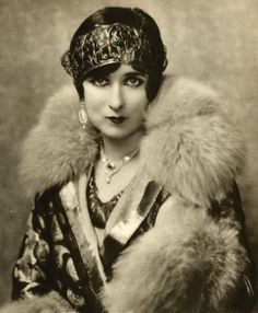 Elegant evening out as styled by Ms Mildred Harris, 1926...a head band, a touch of sparkle and a fur trimmed collar.