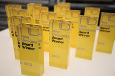 I love these awards, they have a modern look. I would do these in a different color other than yellow, probably grey with teal. Corporate Awards, Corporate Design, Business Design, Event Design, Signage Display, Signage Design, Black And Gold Theme, Acrylic Trophy, Plaque Design