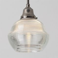 Vintage Holophane - these guys took industrial lighting to an art form (this place uses the vintage glass and fits them with spot-on reproduction fixtures & all new wiring etc. Pretty great.)