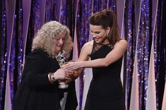 Kate Beckinsale Photos - Actress Kate Beckinsale (R) presents the Excellence in Fantasy Film award to costume designer Jenny Beavan for 'Mad Max: Fury Road' onstage during the 18th Costume Designers Guild Awards with Presenting Sponsor LACOSTE at The Beverly Hilton Hotel on February 23, 2016 in Beverly Hills, California. - 18th Costume Designers Guild Awards - Show and Audience
