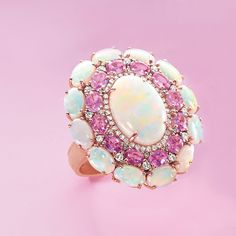 Oval opals flash their signature color play with pink sapphires and diamond accents. This cocktail ring will take your outfit from simple to seriously statement-making! Item no. 878227