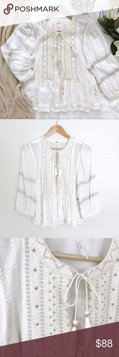 """Free People 'Wild Life' Embroidered top Dreamy, ultra-soft boho top with tasseled ties, beautiful embroidery and subtle embellishments all over. Also features billowy sleeves with a buttoned cuff, and unfinished edges for a lived-in look. Easy, flowy shape, semi-sheer.  - Approx: Bust: 39"""", Length: 21.5"""", Sleeve Length: 18.5"""" Free People Tops"""