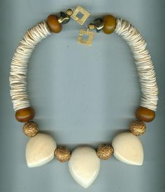 By Anne Marie |  Three pre-ban large ivory hearts from the 1930s/1940s are strung with 24 ct gilded copper beads, African amber (phenolic resin) from the African trade and ancient shell heishi.  |  BeadArt Austria Designs | 480$