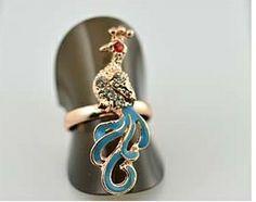 Bague reglable paon en vente ici http://www.pyramideauxbijoux.com/bijoux/bagues-4/bague-reglable-26.html