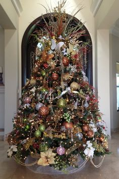 Copper, gold and green Christmas tree....like the double strand of pearls around the bottom of the tree