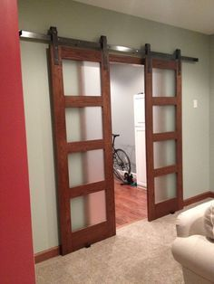 Office sliding door idea...  The track will have to span past the openings to allow doors to slide back.