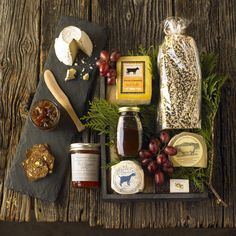 Winston Flowers' Gourmet Gift Collection pairs the rustic flavors of Jan's Farmhouse Crisps with the savory notes of four New England farmhouse cheeses.