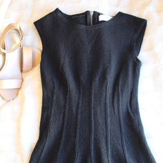 Anthropologie Wool Dress This beautiful dress is made of wool and is in excellent condition. It's the perfect little black dress. I'm a size 6 and this small fits me. Open to offers! Anthropologie Dresses Midi