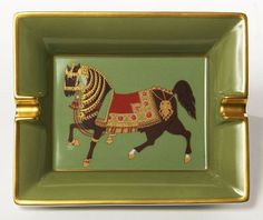 White Limoges porcelain ashtray with a hand painted horse on olive green background and gold border for Hermes