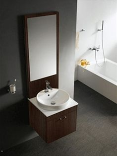 This beautiful bathroom vanity helps you to make a relaxing and comfortable bathroom. It is a modern single sink bathroom vanity made up of soft closing hardware. The cabinet is made from a solid wood with black walnut finish and it contains one white, above-counter top ceramic sink with a single hole for a faucet. Its market price is $1192. 62 but from home living style you can get this only in $917. 40. Place your order today.