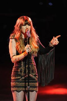 Juliet Simms -  something like this. longer, more open sleeve, formed into a fingerless glove.