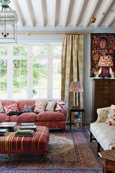 Blue Living Room with Red Sofa and Antique Textiles in Living Room Design Ideas. French country living room painted a soft blue with George Smith red sofa covered in a vibrant collection of cushions. Country Style Living Room, Country Style Homes, French Country House, French Country Decorating, French Cottage, English Country Style, Country House Interior, Country Kitchen, Rustic Style