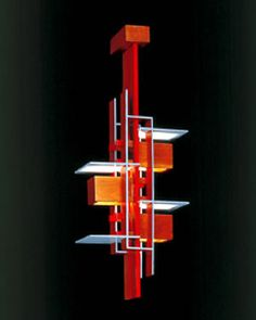 Taliesin Pendant designed by Frank Lloyd Wright, cherry wood with light blue plates and red edges. Euroluce Lighting Australia.